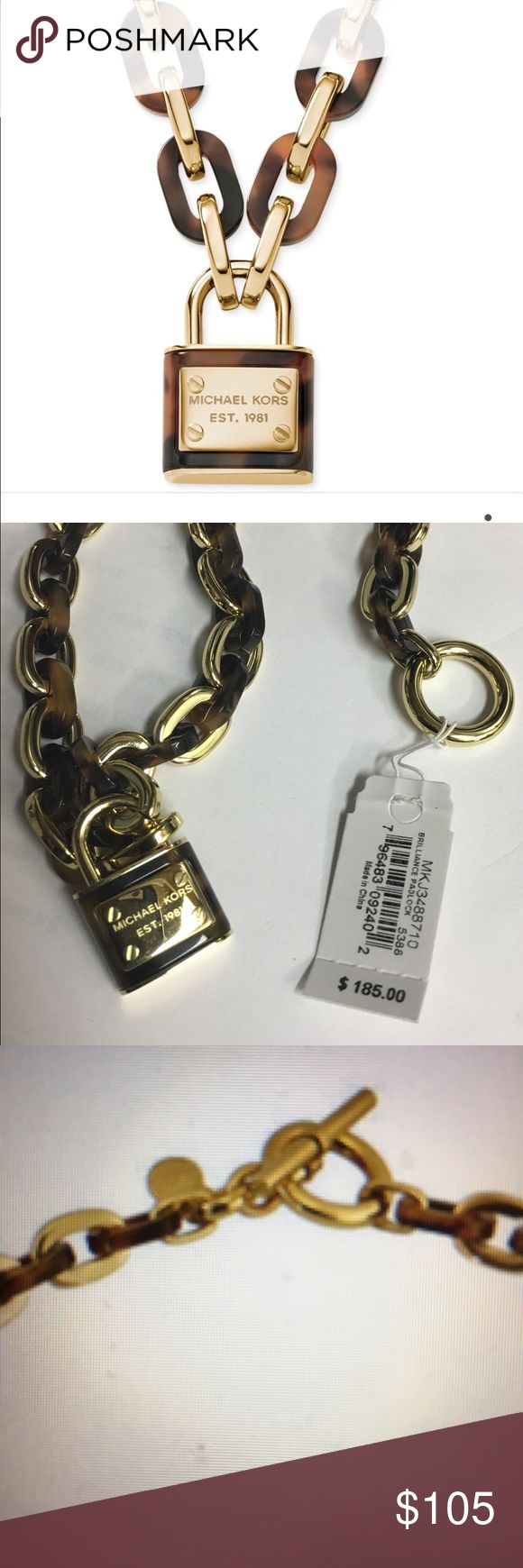 """Michael Kors Gold Tone Logo Padlock Necklace Michael Kors MKJ3325710 women's gold-tone logo Padlock pendant necklace is offered, in a yellow gold plated solid stainless steel. This model is made in dimensions of 18"""" long. This necklace has lustrous hardware and signature logo charms and lock. Michael Kors Jewelry Necklaces"""