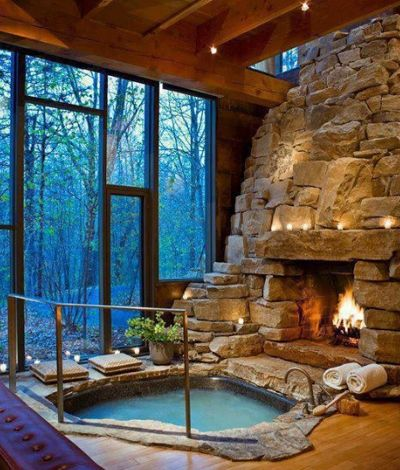 Rock Bathtub With Fireplace. This is amazing.