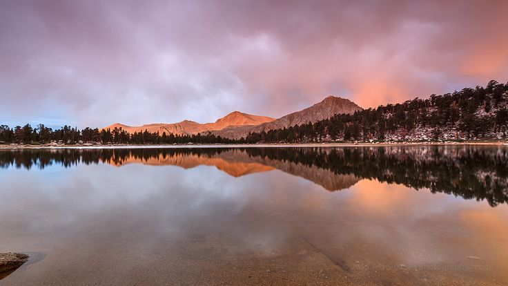 https://flic.kr/p/zzv1Tz | Muir Lake Morning Reflection | This was captured at dawn at Muir Lake in the Golden Trout Wilderness in the Southern Sierra. The most intense summer storm on record for Southern California was on its way that night, and the clouds in advance of it provided a great light show as the first light of the rising sun struck the surrounding peaks. This was a 6+ mile hike from the Horseshoe Meadows trailhead, mostly around 10,000 feet in elevation. The rain started bef...