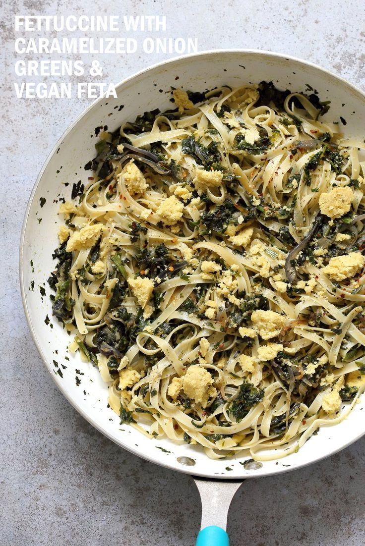 Fettuccine with Caramelized Onions, Greens and Vegan Feta -ish cheese. Easy Weeknight meal.1 Pot and 30 minutes w/ make ahead cheese. Vegan, can be Gluten-free, Soy-free