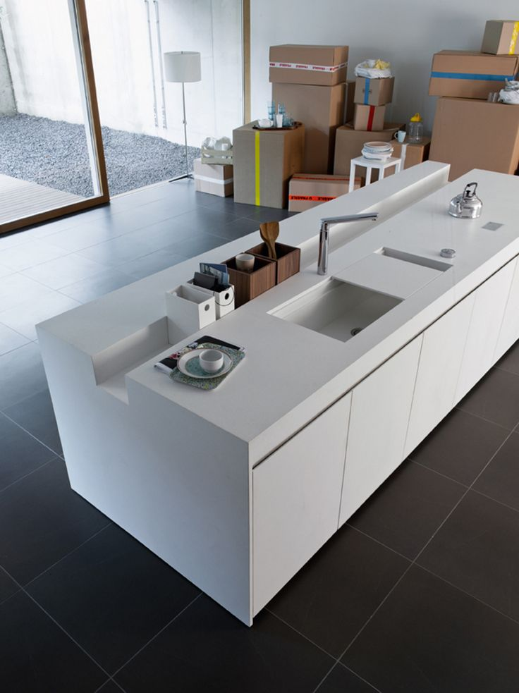 The recess in the counter is sheer genius. So is the sliding sink cover, much more sleek and integrated than others.