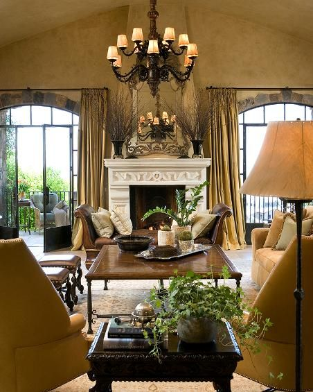 Living Room with Iron Doors and Limestone Fireplace