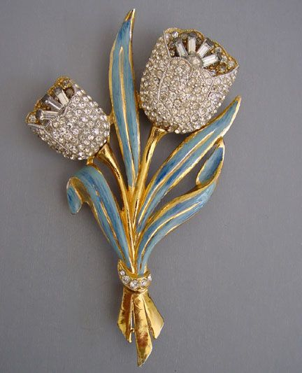 I'm fortunate to have this brooch in my collection!!   Coro - tulips trembler brooch with blue enamel leaves and clear rhinestones, 1939