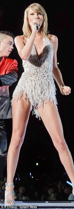 Super fit: TSwift displayed her lean legs in a fringed silver bodysuit