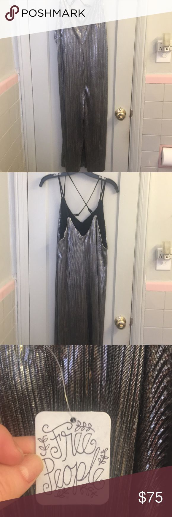 Free People Silver Jumpsuit Fun sexy jumpsuit that can be worn alone or layered under a turtle neck! Gives major glam / Studio 54 vibes Free People Other