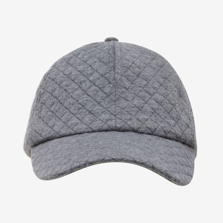 The Quilted Jersey Cap is the perfect wa to top off your sporty weekend look. Features an adjustable back strap and brushed silver hardware. 96% Polyester 4% Spandex. Cold hand wash separately.