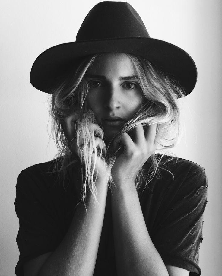 Janessa Leone hat & distressed tee. Via Mija