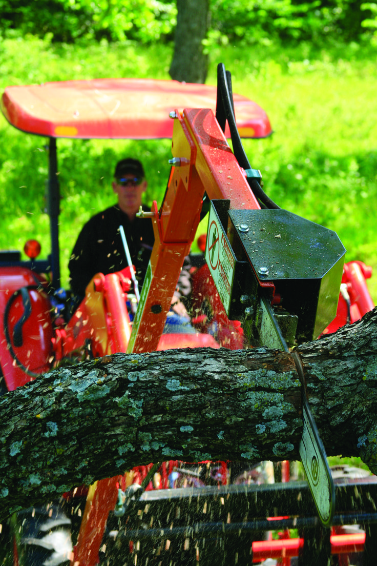 Trim trees from the safety of your tractor seat instead of the bucket