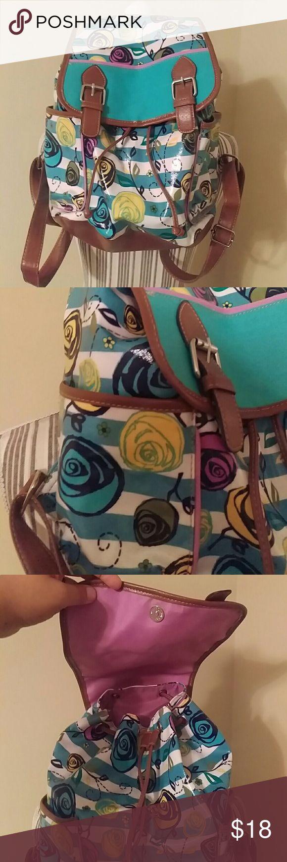 EUC! Faux Leather/Vegan Pull Tie Bookbag/Purse EUC! Faux Leather/Vegan Pull Tie Bookbag/Purse So freaking cute! Multi color with purple on the inside Floral design.  Medium sized bag Bags Backpacks