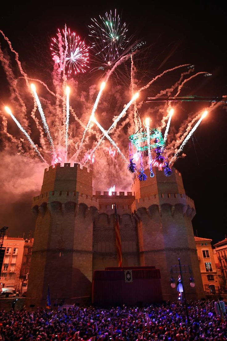 "Valencia celebrates the ""Cridà"", the event that marks the kick off of the Fallas. The ""Fallera Mayor"" announced the start of Fallas from the top of Torres de Serranos (one of the remaining doors of the ancient wall of the city) to all people attending. www.turisvalencia.es"