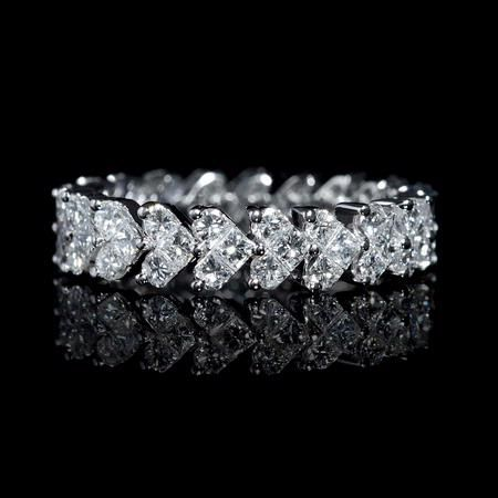 NEW: Diamond eternity wedding ring featuring hand selected princess cut and half moon diamonds 1.94ctw forming fancy heart shaped designs. #WeddingWednesday #love