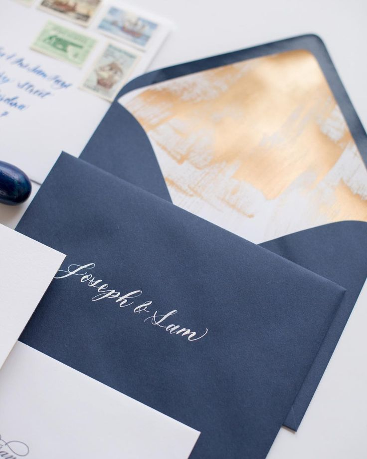 Hand painted envelope liner with white calligraphy on navy envelope.