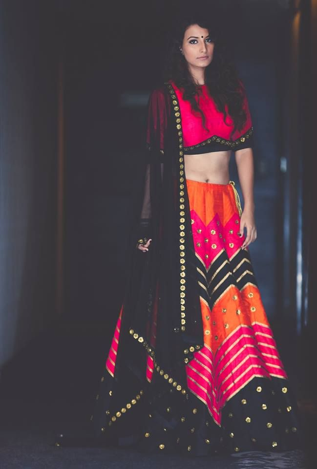 Pretty pink, orange and black lehenga and blouse. Indian fashion.