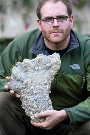 Josh Gates is shown above with the Yeti footprint cast, dated December 1, 2007, from his Nepal expedition.