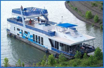 Kentucky's Lake Cumberland Riverboat Cruise.  Sleeps 12, 6 bedrooms, one and half baths, party deck, central air, gas grill, two water slides, hot tub.  $328 per person for a week