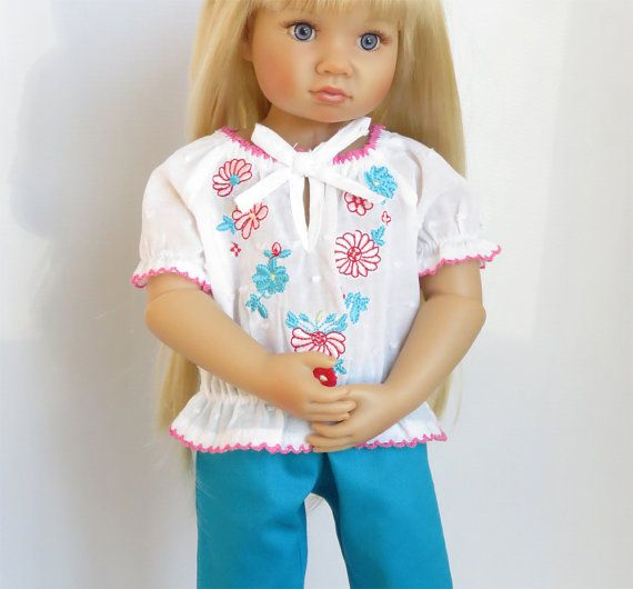 Includes: top and pants    The lightweight white peasant top has embroidered pink and turquoise flowers. Fits over head.    The turquoise pants