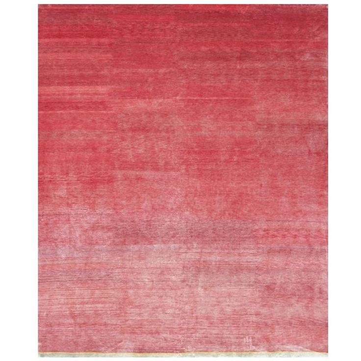Raspberry pink silk carpet. Thin edge of green on…