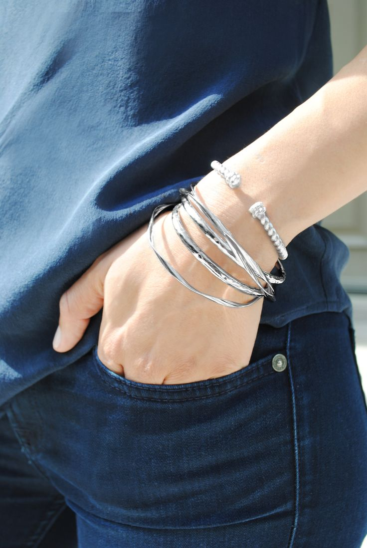 Founder Delilah Kanou shows us how easy it is to update a casual outfit by stacking some sterling silver bracelets from DelilahK's latest collection, proving that even small changes can enhance our style.