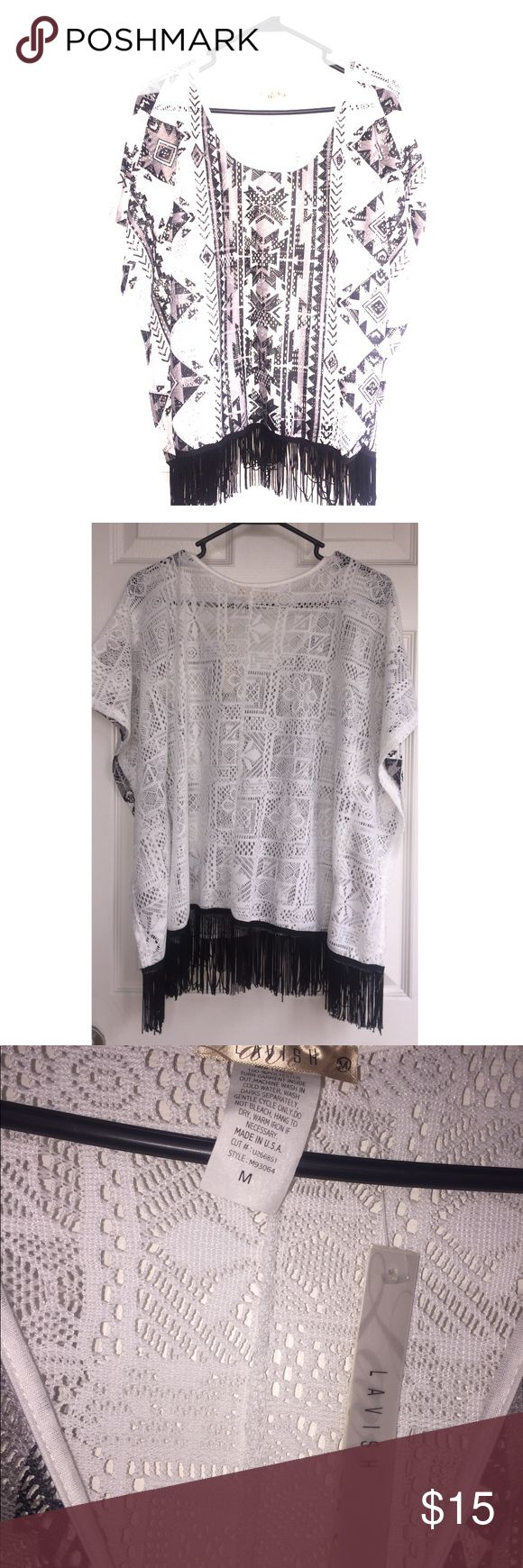 Fringe blouse Bottom fringe, native southwest designs, black and white, see threw. Never worn, tag still on there. Tops Blouses