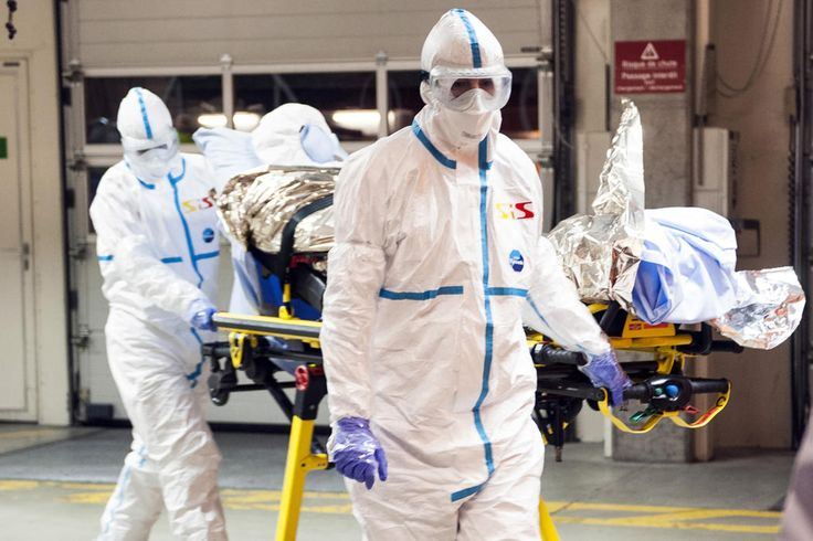 In this photo provided by the Geneva University Hospital (HUG), Cuban doctor Felix Baez Sarria, who contracted Ebola in Sierra Leone, arrives on a gurney at the Geneva University Hospital in Geneva, Switzerland, Friday, Nov. 21, 2014. Baez, a member of the 165-person medical team Cuba sent to Sierra Leone to help with the Ebola outbreak, caught the disease when he rushed to help a patient who was falling over. (AP Photo/Julien Gregorio, Geneva University Hospital)