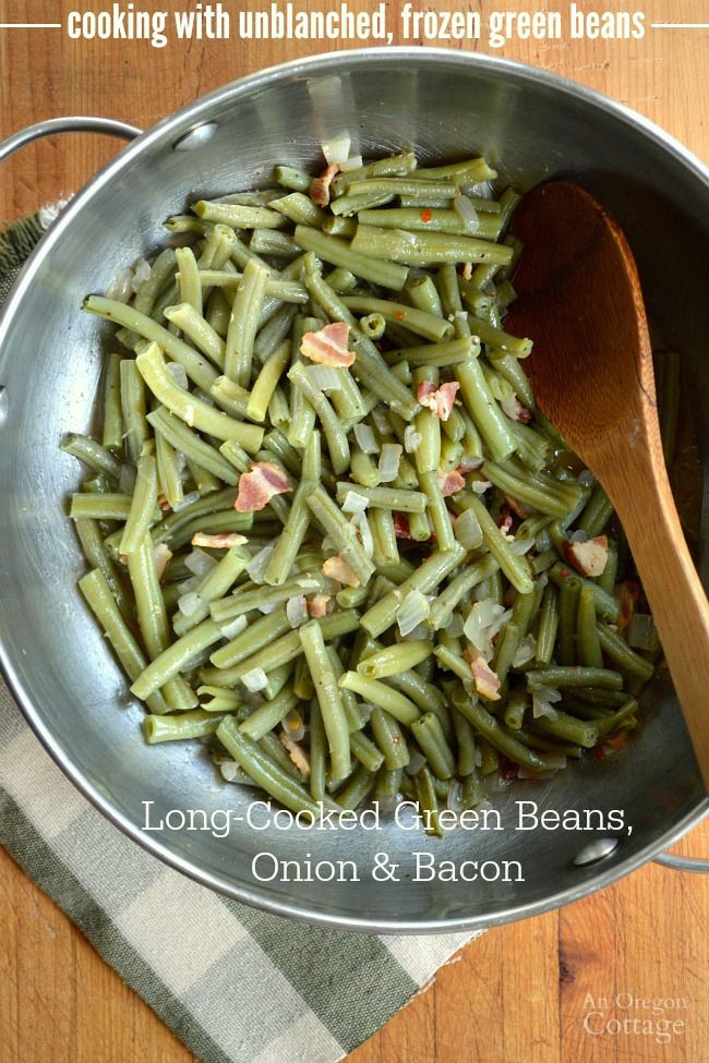 Cook your unblanched, frozen green beans into this time-honored side dish: a long-cooked (15 minutes) green bean recipe with bacon and onion.