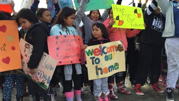 Children from Neskantaga First Nation greet Carolyn Bennett, minister of indigenous affairs, at the airport in the northern Ontario community on Friday.
