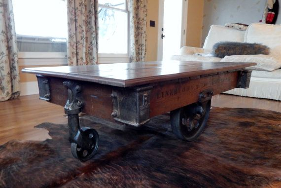 Rustic warehouse coffee table on iron casters for Rustic coffee table with casters