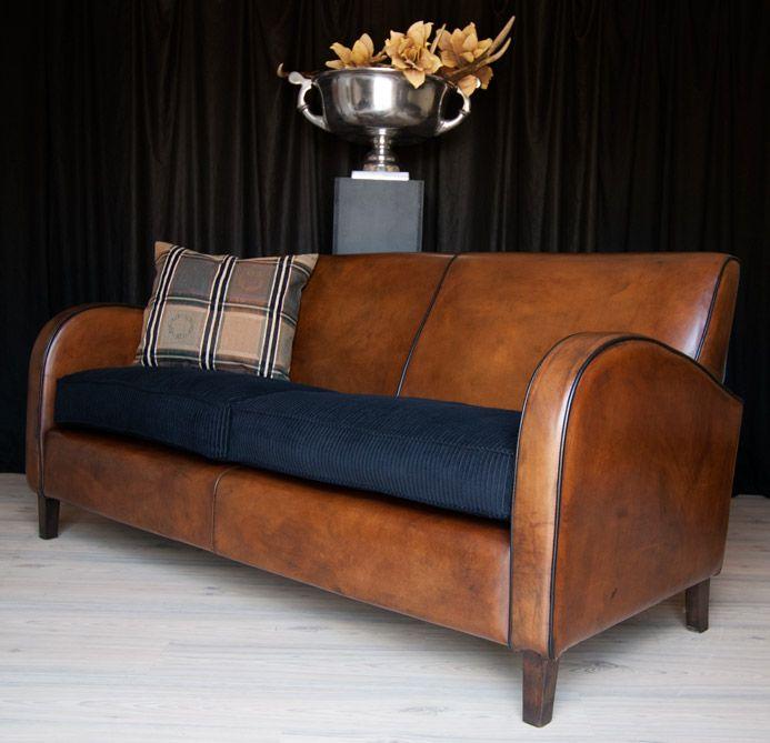 Beautiful Art deco sofa of King's design | Original European leather chairs and sofa's