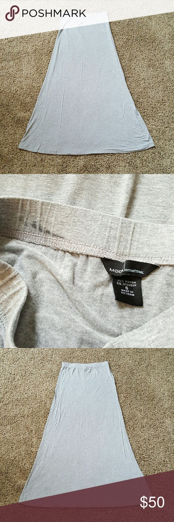 "⚀ SUPER SALE! VS Maxi Skirt Light Gray In excellent condition!  Second pic shows a dark gray mark inside band, does not show through, I believe its from their dye process.  Bought through Victoria's Secret Website, tag says Moda Internarional.  Super soft and stretchy maxi skirt.  Color is a washed light gray, silver.  Laying flat and unstretched waist measures about 13&1/2"", length is about 40"".  I love these but am thinking about switching to dresses.  Offers/negotiation is welcome…"