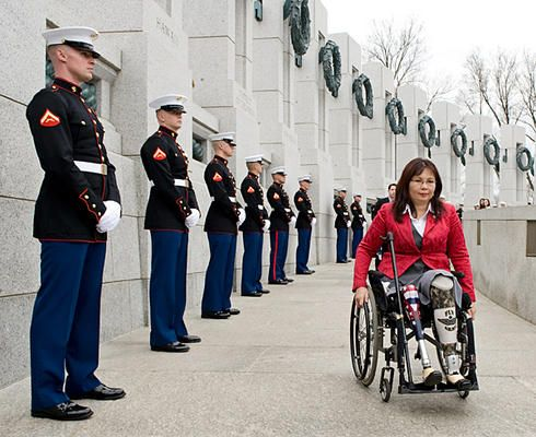 """Tammy Duckworth, former assistant secretary of the US Department of Veterans Affairs (at the World War II Memorial in Washington, D.C.),lost her legs in combat while piloting a Black Hawk helicopter. """"When I'm asked if the country is ready for women in combat, I look down at where my legs used to be and think, 'Where do you think this happened, a bar fight?'"""" (Photo courtesy of the Christian Science Monitor.)"""