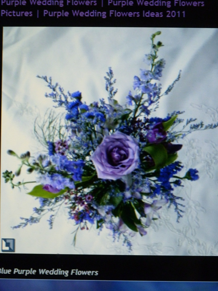 wedding bouquet-white roses,blue roses,pink roses,purple roses, orange tiger lilies  with sprigs of ivy -use this as template for design bouquet-love the colors of this bouquet