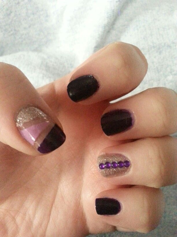 cute purple dominated gem nails.