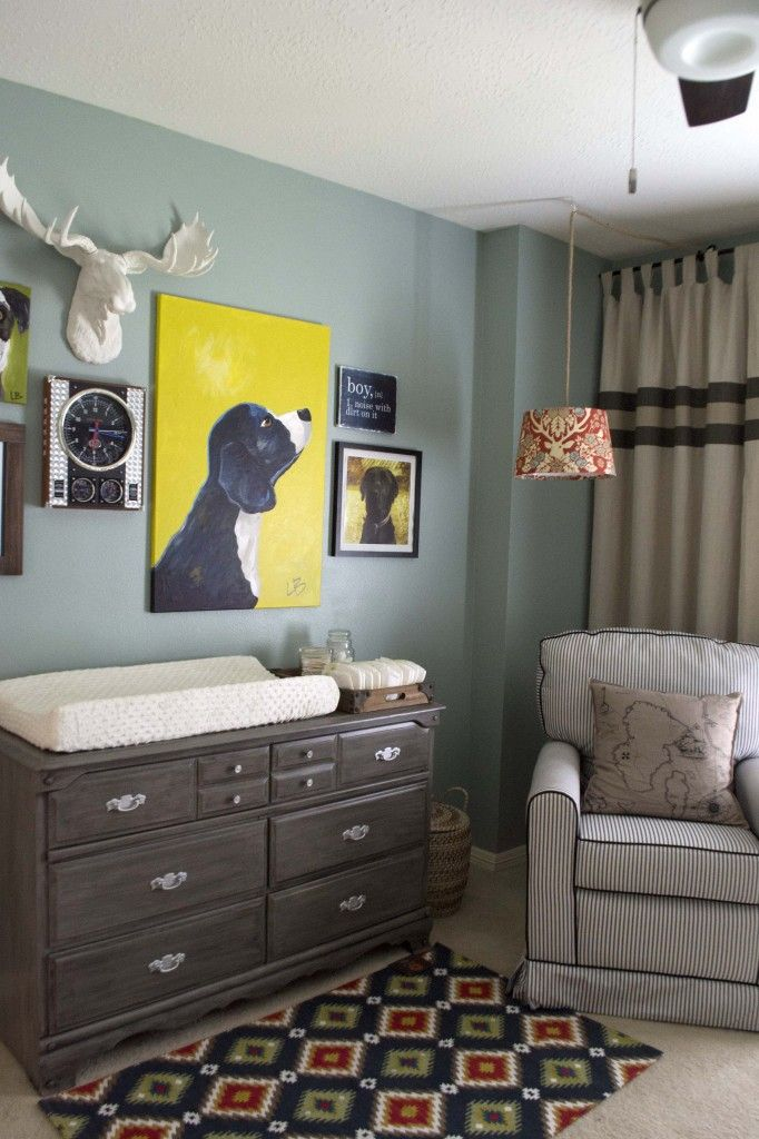 cute art above dresser  i love these deep muted colors for a boys room.  dark and light grays, blues, navy