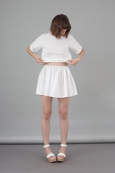 'THE FOLDED LOOKS' - CANDY Flavia La Rocca Four modules that disclose eight different looks. All in a clutch. #flavialarocca #cotton #whitedress #whiteclutch #whiteskirt
