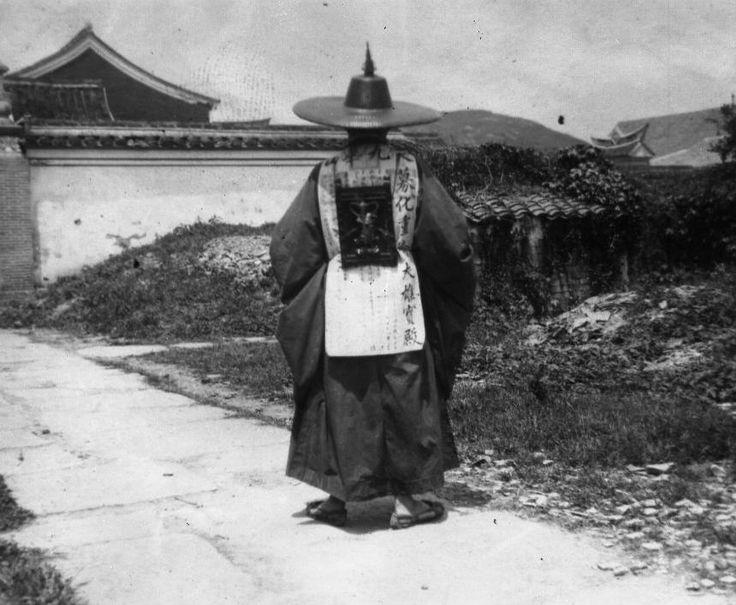 Pyongyang ca 1910-1930. A dignitary on a sidewalk.