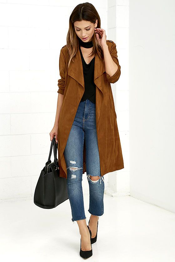 Slip on the Take On the World Tan Suede Trench Coat and you'll be ready for anything! Faux suede forms this luxurious coat with shoulder epaulets, front gun flaps, and an overlapping storm flap at back. Notched collar drapes into a dreamy open front that secures with a tying sash belt. Long sleeves and kick pleat.