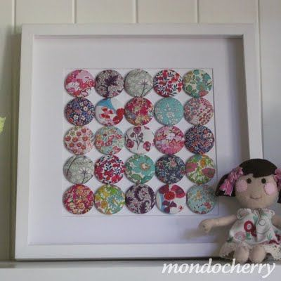 Mondocherry Fabric Covered Buttons. Thinking if the various fabrics used for a wedding were used, nice wedding keepsake. Or baby clothes used. Make a mongram insead of a square.