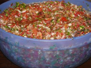 kitchen addiction: Canning Salsa.  This recipe looks amazing!  Looks like I know what I'm going to do with all our salsa tomatoes now :)