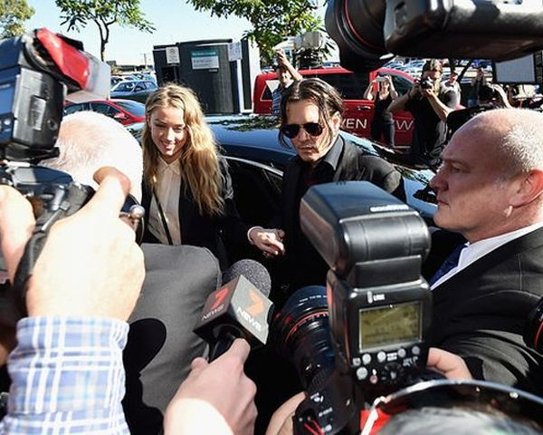 Watch: Amber Heard Johnny Depp Look & Sound Like Robots In Video Apology To Australia - http://www.morningledger.com/watch-amber-heard-johnny-depp-look-sound-like-robots-in-video-apology-to-australia/1367107/