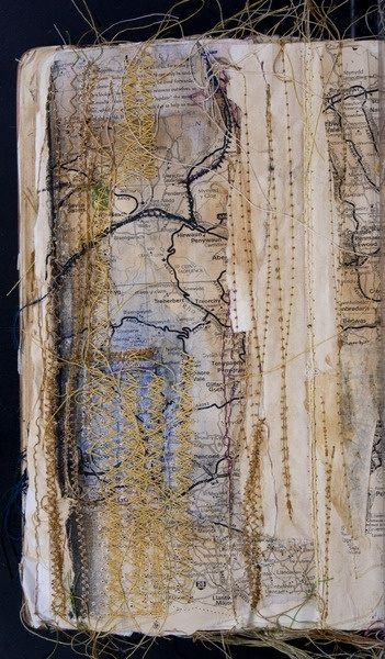 This combination of maps and stitching is really interesting...could be some vine is growing thru the journal
