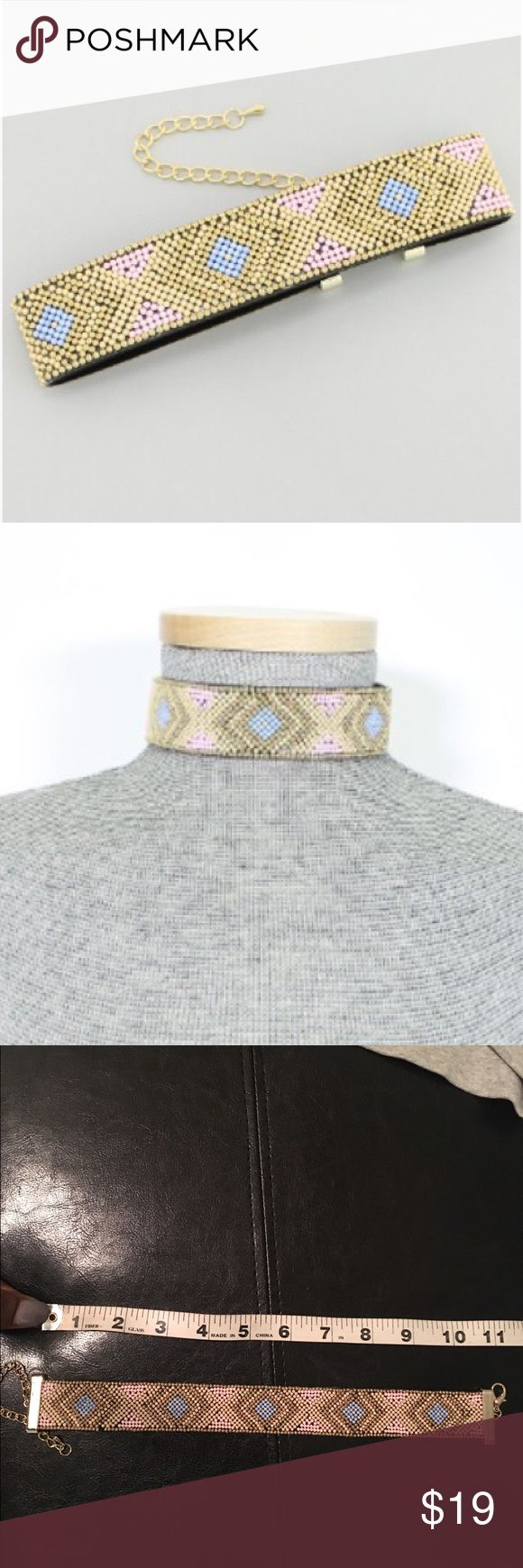 Pastel Aztec tribal pattern choker This beaded choker is a great way to stay on trend. beaded choker features an aztec style pattern.  The necklace has gold plated clasps at either end.  11in. X 1.25in. Jewelry Necklaces
