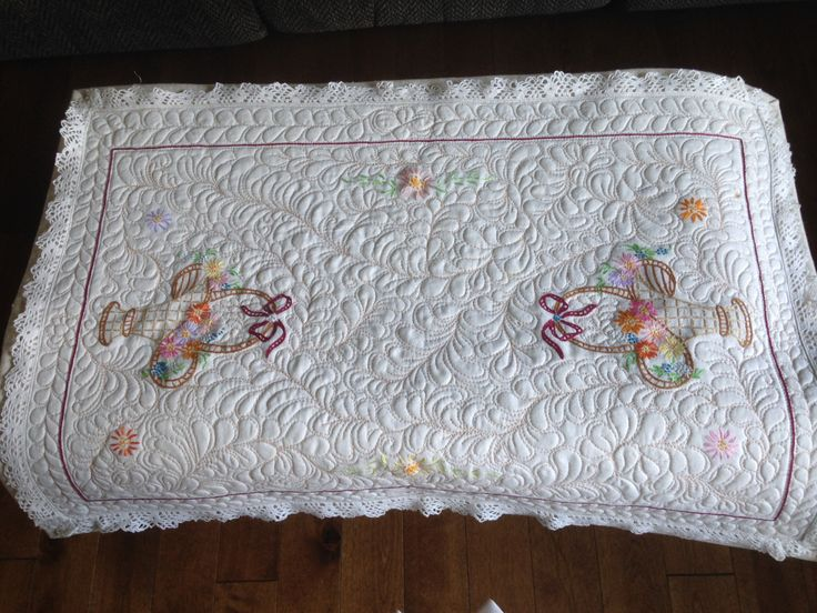 Vintage hand embroidered dresser scarf.  Updated by sandwiching and free motion quilting
