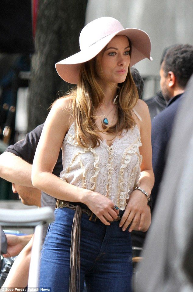 Frills: The star showed off a delicately ruffled blouse and belt with hanging fringe detai...