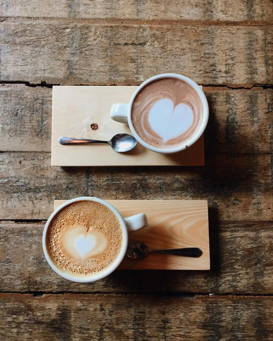 I <3 the idea of serving coffee cups on boards - so cheap to stain pine with a slight indent to hold the cup in place.