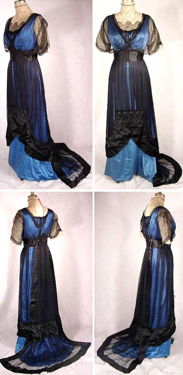 Evening gown ca. 1912. Blue silk satin with black silk chiffon and black satin overlay, trimmed with black passementerie and metallic gold & ecru lace.