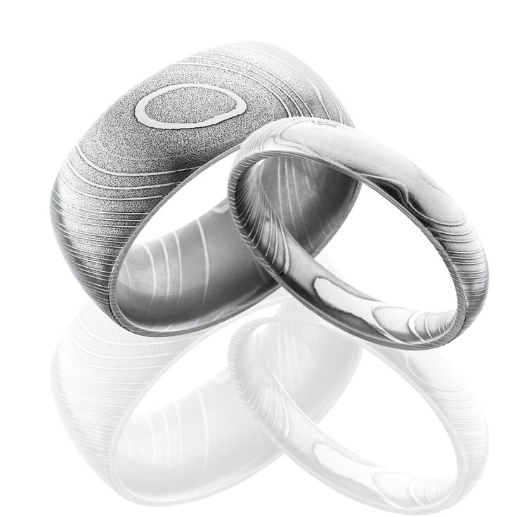 This Damascus Steel wedding ring set is perfect for couples who want uniqueness and style. He'll love His because it will be 10 mm wide, and Hers will be 4 mm wide, both with a domed profile.