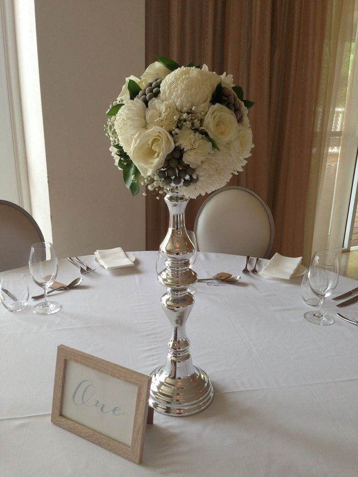 Rose, chrysanthemum, carnation, brunia and baby's breath pomander candlestick table arrangements by Scentiment Flowers