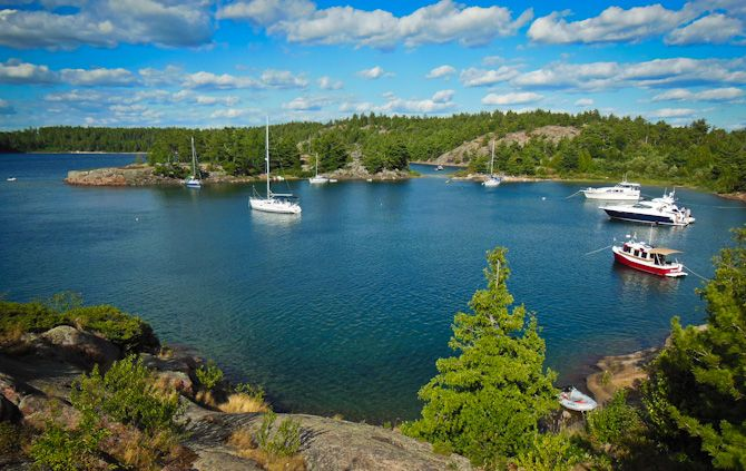 boats docked in an amazing inlet at Croker Island – North Channel, Ontario, Canada