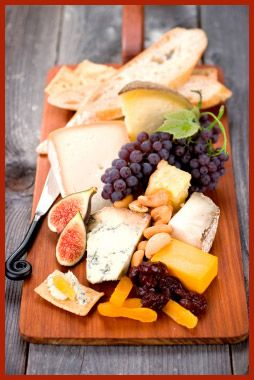 My cheese board must at least consist of Brie, Camambert, and some Goat cheese...served with cranberries and figs