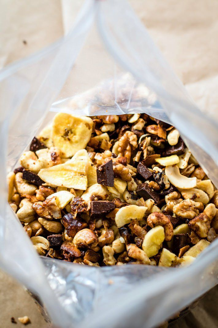 Crock Pot Chunky Monkey Paleo Trail Mix! A healthy gluten free trail mix that will definitely give you energy, whether actually on a trail or snacking on the go! This chunky monkey paleo trail mix is one that you can make easy in the crockpot and you can make lots of it. Get ready to munch on a handful mix of nuts, coconut, dark chocolate fudge chips, banana chips, and more!